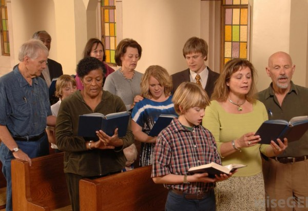 group-of-worshipers-in-a-church-looking-at-bibles